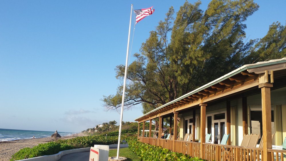 Briny Breezes Oceanfront Clubhouse w-Flag.jpg