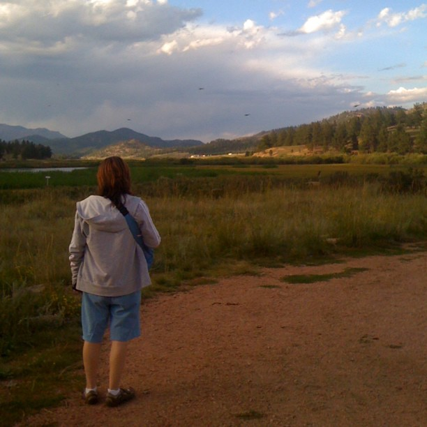 What a view. Everything is right in the world. My siSTAR reveling in the #mountains.  (Taken with  Instagram  at pike national forest, co)