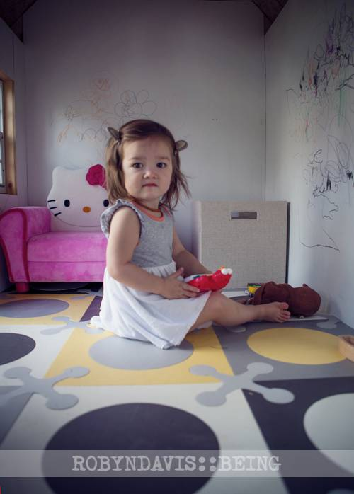 Mizz Mackenzie and her cool new backyard playhouse. :)