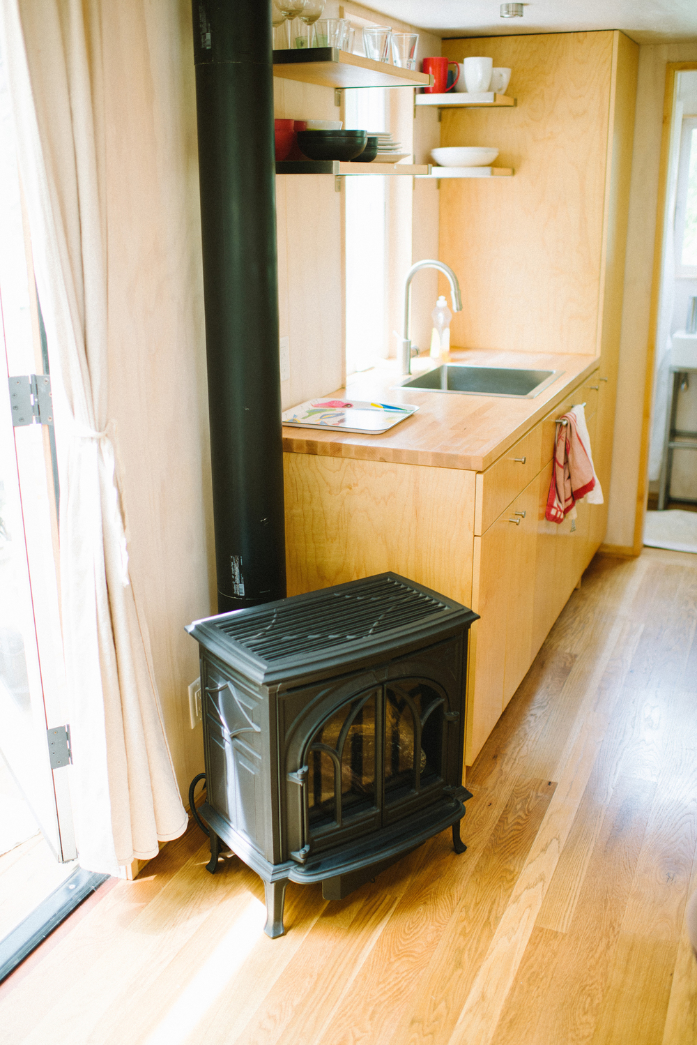The Honest Home Podcast | Vina Lustado's Tiny Home| Tiny Home Stove | Photo by Tina Loveridge