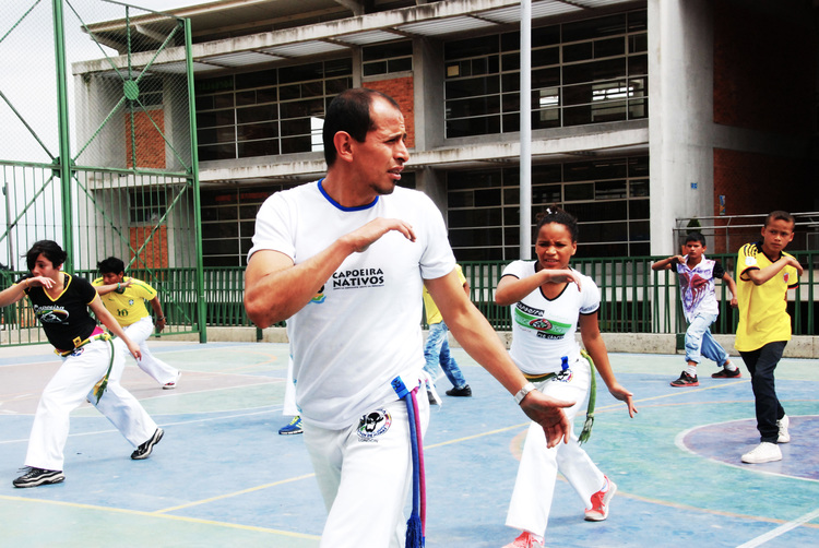 Cristhian with youth from Ciudad Bolívar practicing at the local school.