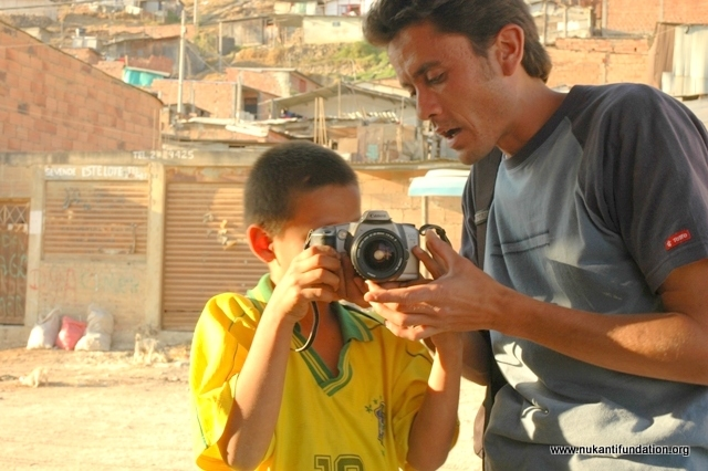 One of our volunteers teaching photography to children from deprived communities.