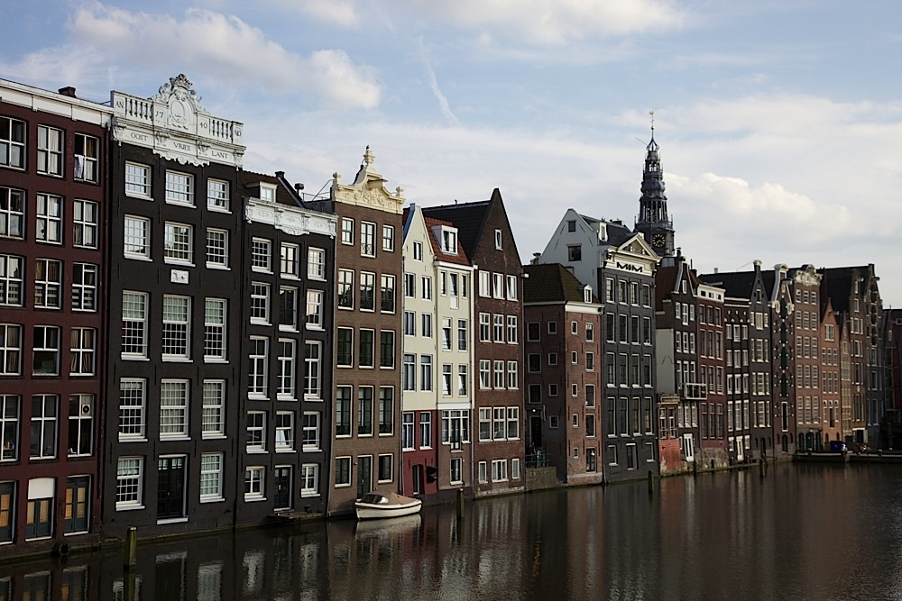 Pretty homes/businesses along a canal in Amsterdam, The Netherlands.
