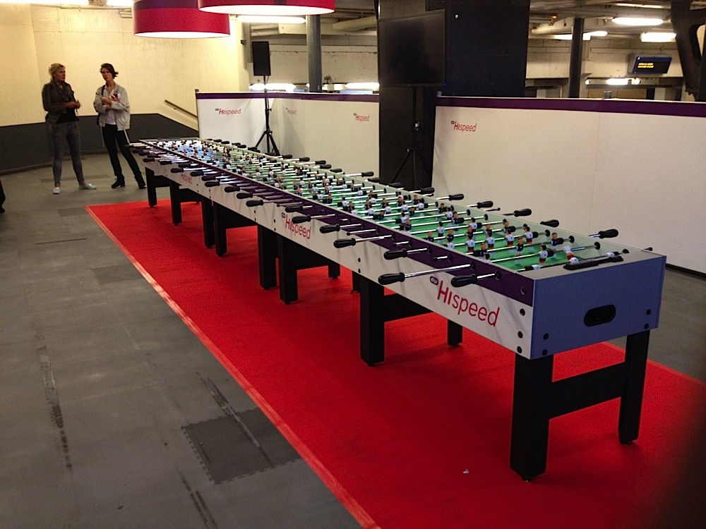 A very long foosball table set up in Amsterdam Centraal train station in Amsterdam, The Netherlands.