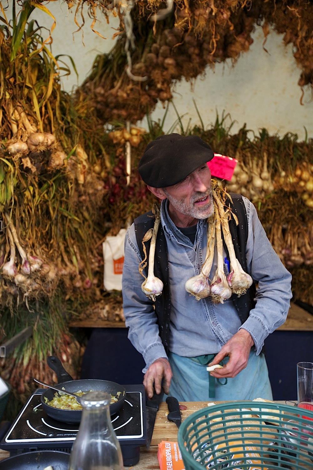 A guy selling garlic at a market in Ghent, Belgium.