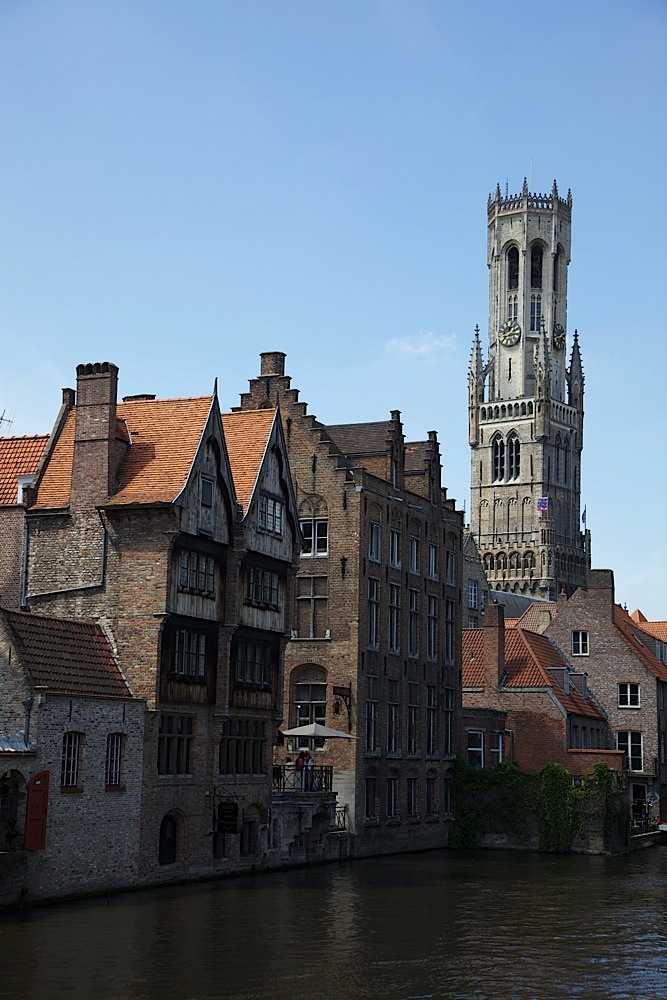 My hotel (the wood and brick building with the two pointed roofs) with the Belfort in the background in Bruges, Belgium.