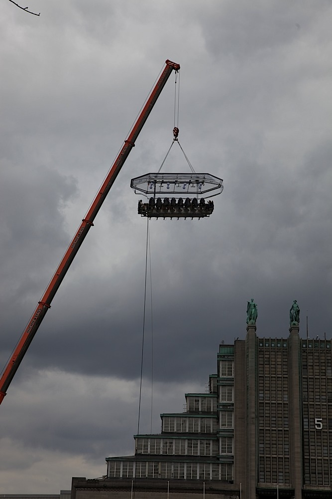 One of those sky-table things where you can have a meal suspended from a crane in Brussels, Belgium. I had never seen one in person. (See:http://www.dinnerinthesky.com/.)