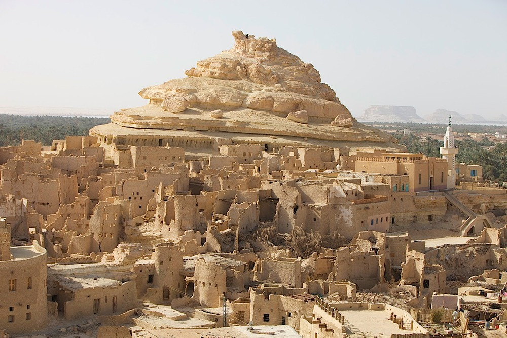 Old Shali, melted village at Siwa. Basically the vllage survived for thousands of years until one day it rained and the water-soluble building materials didn't do too well.