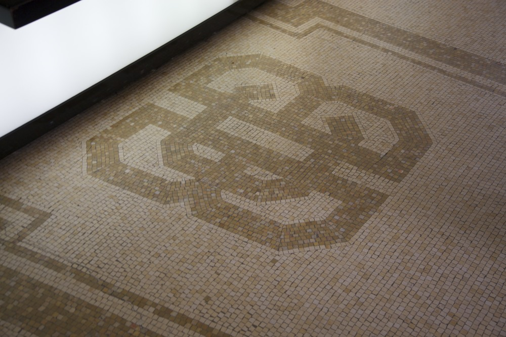 The old (possibly original) BBC logo in a mosaic on the lobby floor of BBC Broadcasting House.