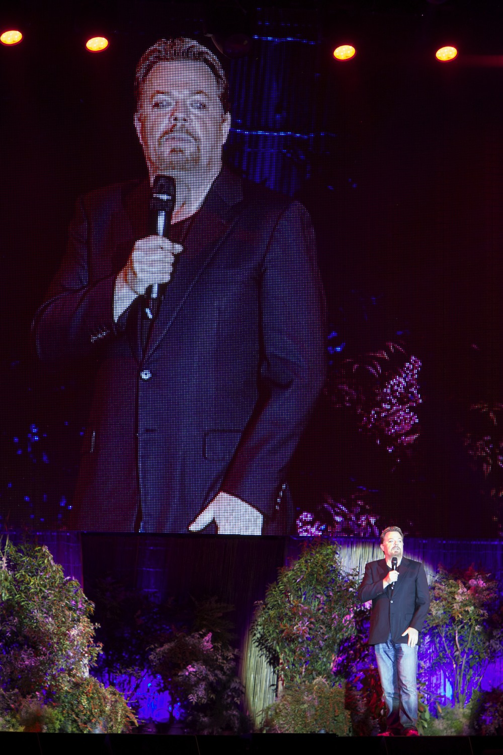 "Eddie Izzard performing at ""Laughs in the Park"" in St. Albans."