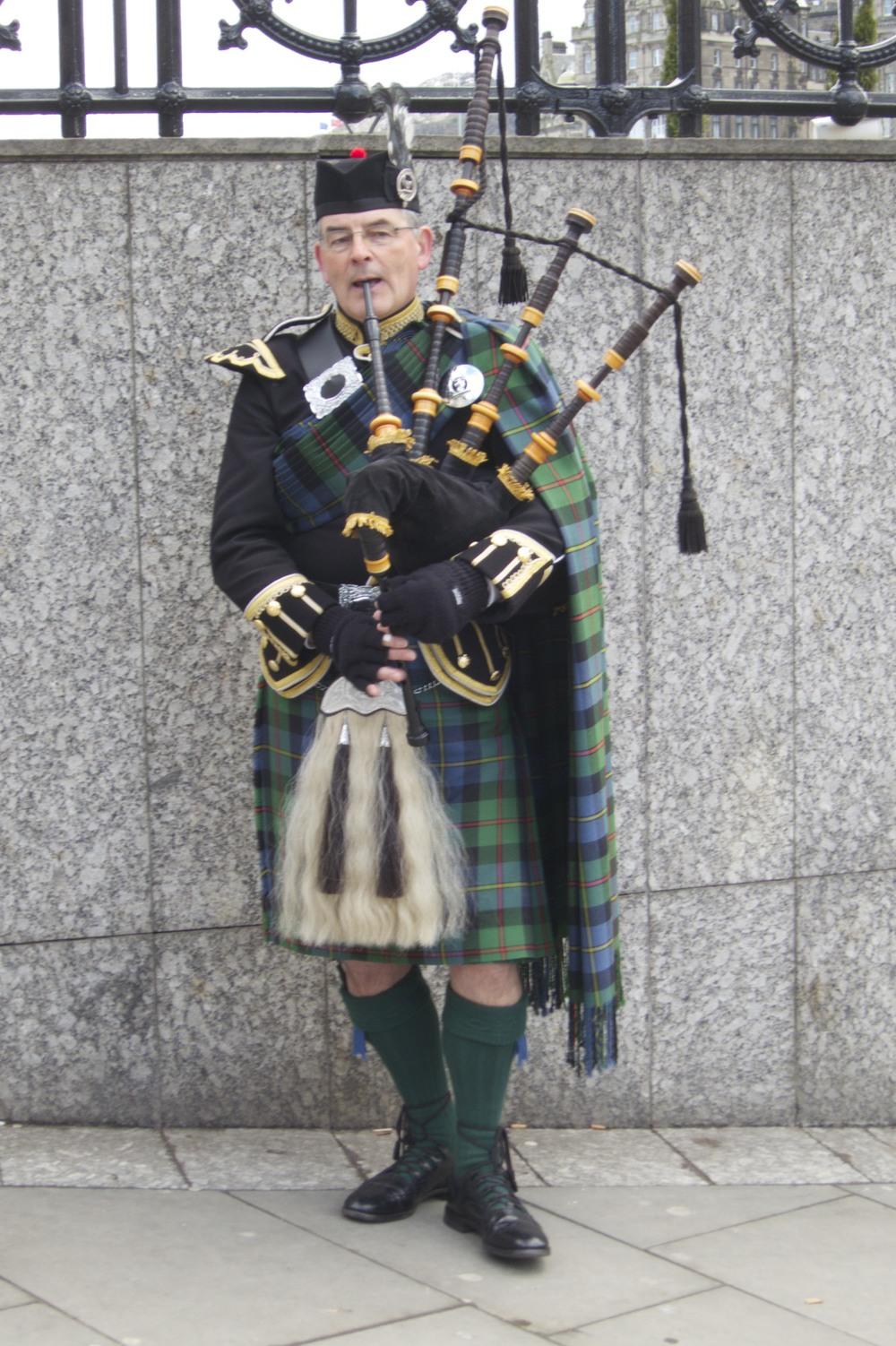 A bagpiper. (Edinburgh, Scotland.)