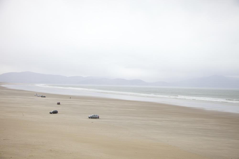 Cars on a beach. (Ireland.)