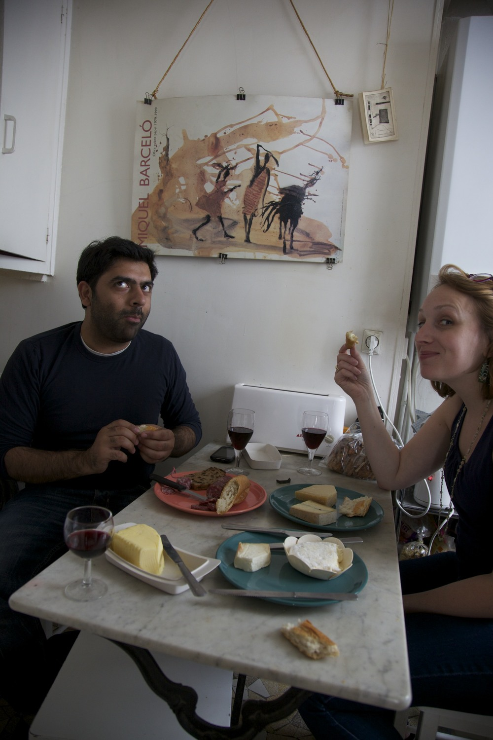 Enjoying bread, wine, cheese, and sausage with Rishi and Julie in the apartment.