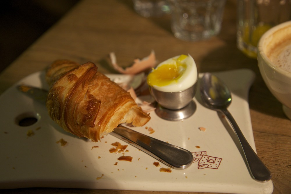 Awesome breakfast -- croissant and a soft-boiled egg.