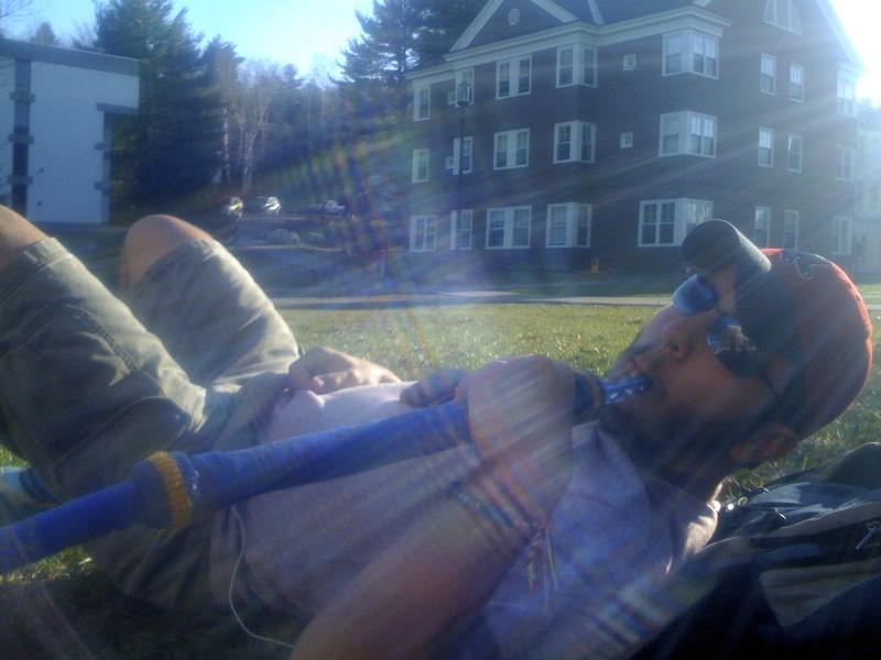 Alex enjoying hookah on the lawn