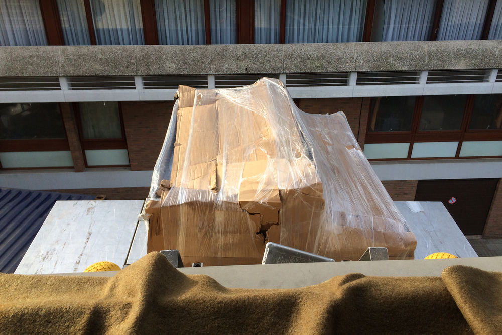 Noelle's piano is delivered through the window of her new apartment. (Brussels, Belgium.)
