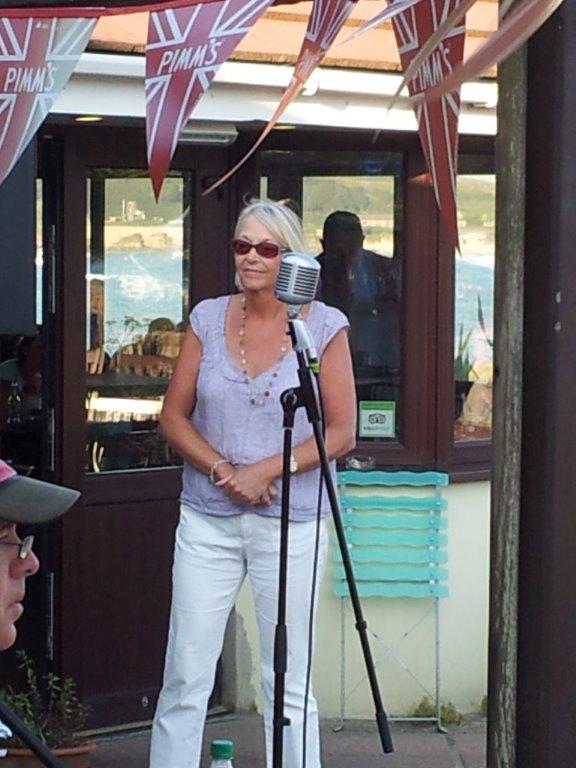 Moira singing.jpg