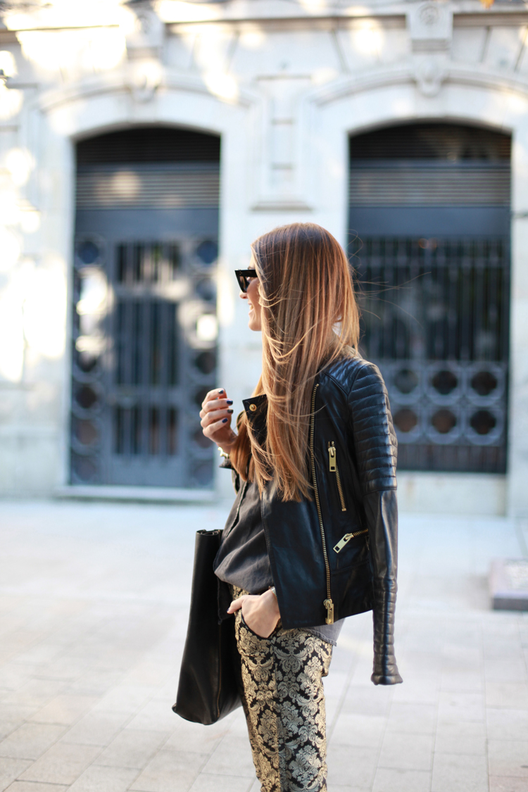 Love the feminine pants with the grungy look of a leather moto jacket.