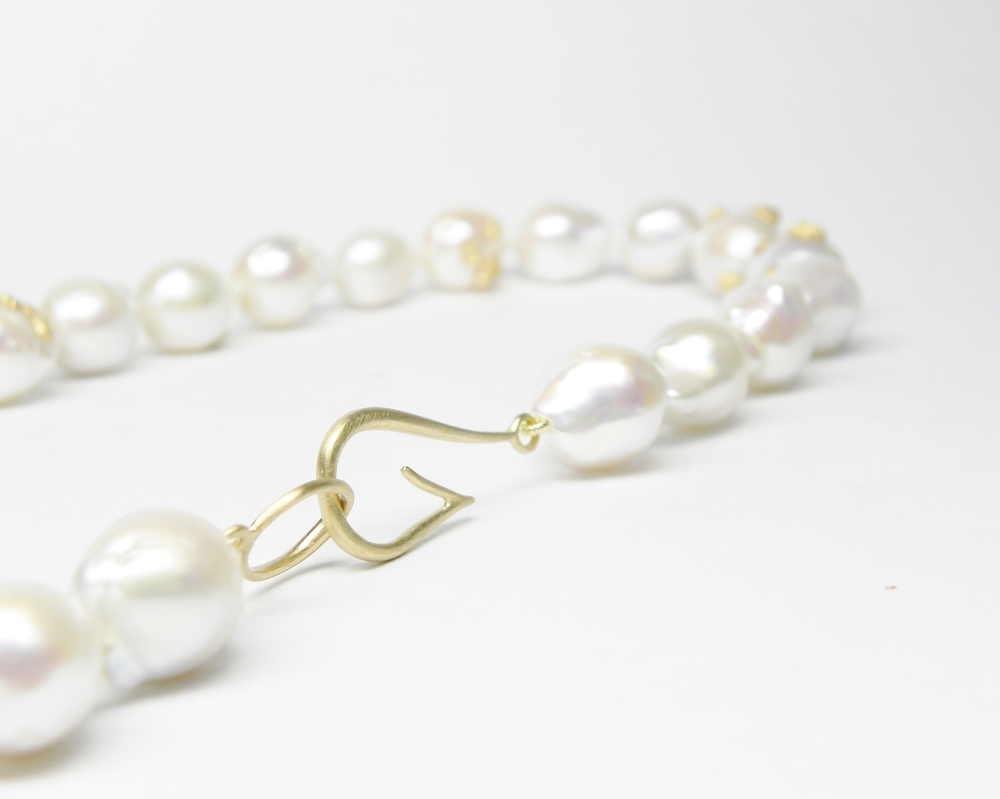 KNOTTED BAROQUE PEARL NECKLACE WITH BARNACLES