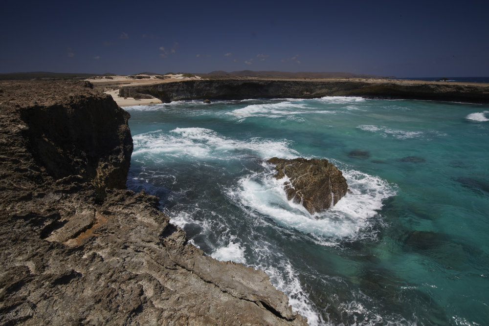 The rocky shoreline of Arikok National Park. Image courtesy of the  Aruba Tourism Authority .