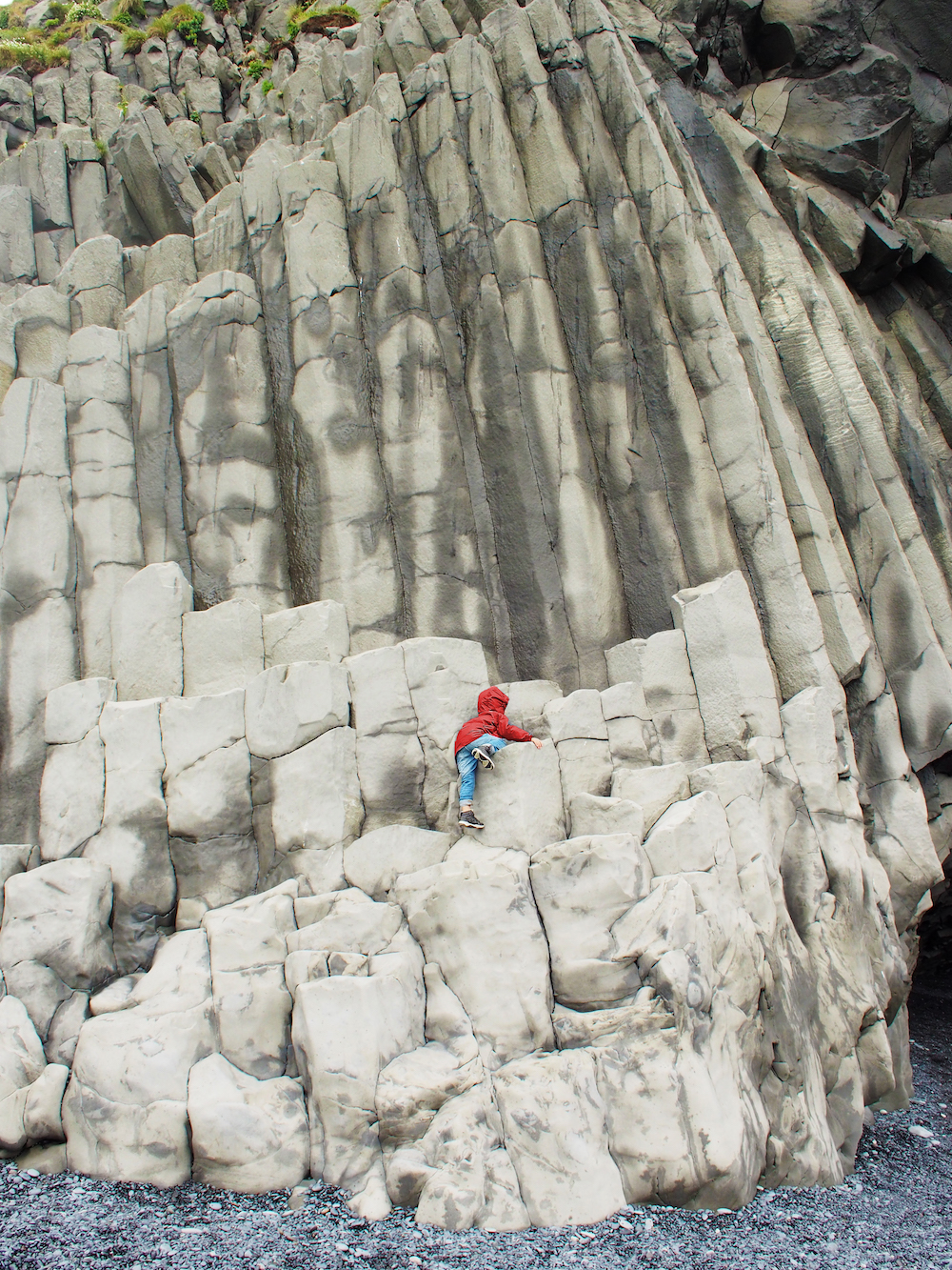Hunter climbing the Reynisfjara basalt columns