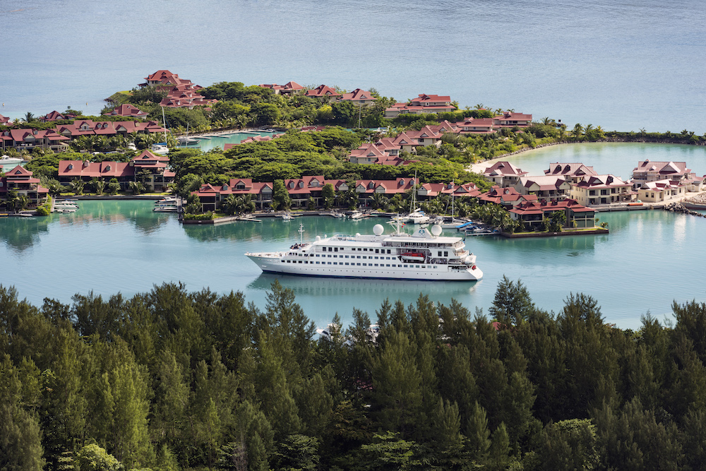 Crystal Esprit, outside of Eden Island in the Seychelles. Image courtesy of Crystal Cruises.