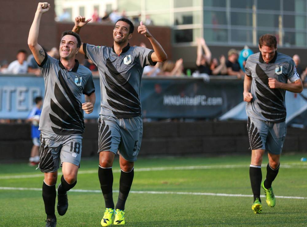 Daniel Mendes, Calvano,  and Aaron Pitchkolan celebrate after Mendes' goal against Carolina last week (Photo from Minnesota United FC)