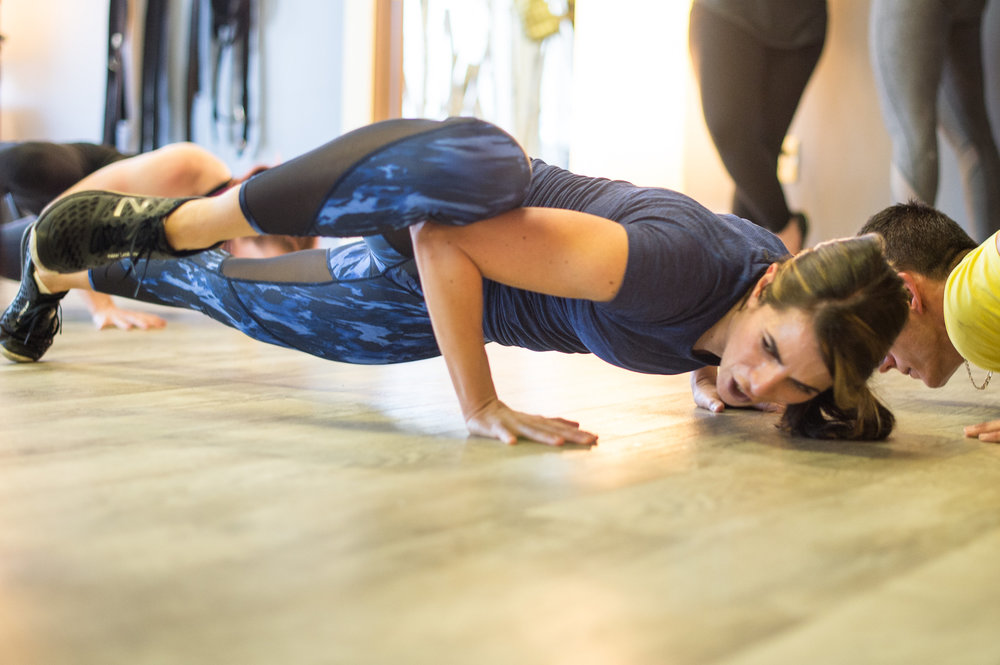 Gina playing with some of her favorite body weight exercises while teaching. Her passion for inspiring others is evident the minute you step through the door.
