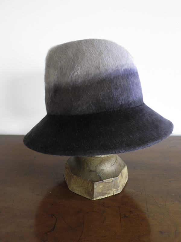 The Katie. Dip-Dye Melusine felt with a tall crown, dented in front.  The brim can be worn down, or curved up (profile)