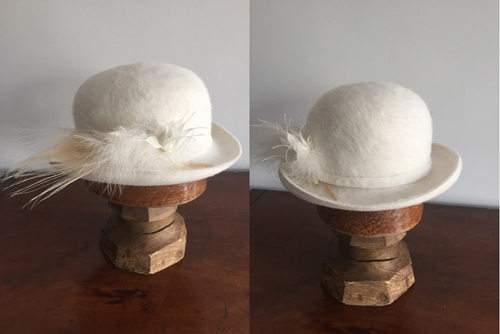"""THE MARLENE""  Ivory lush Fur Felt Derby. For Wedding or special occasions, Melusine Fur felt with bleached Peacock feather and plume.        Price: $350.00"