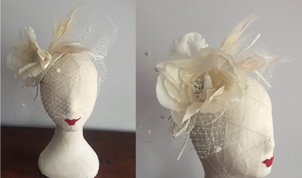 """Delphine""  Ivory  Bridal Headpiece with  pompom birdcage Veil,  silk flower,  Ivory Peacock feathers set on a teardrop shaped base.   Price: $310.00   (note: Head Form is smaller than an actual head)"