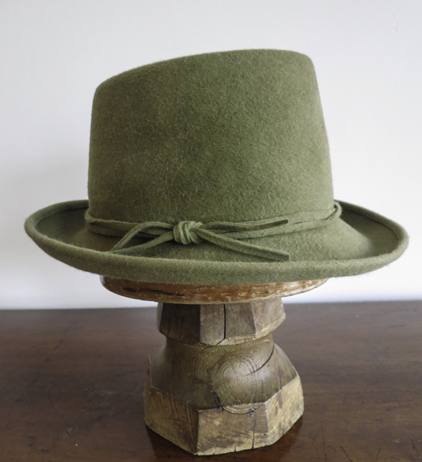 The Hamburg. A smooth suede moss green felt with a trilby brim and a crown that peaks at the front.
