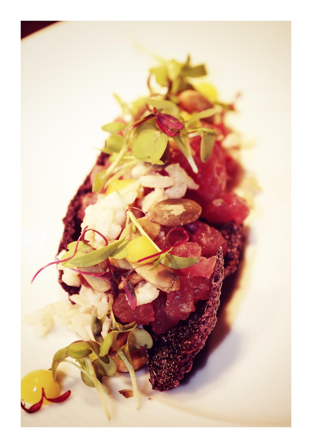 black forbidden rice crisp | bigeye tuna tartare | baby cabbage | yuzu kosho | chewy line nuts |