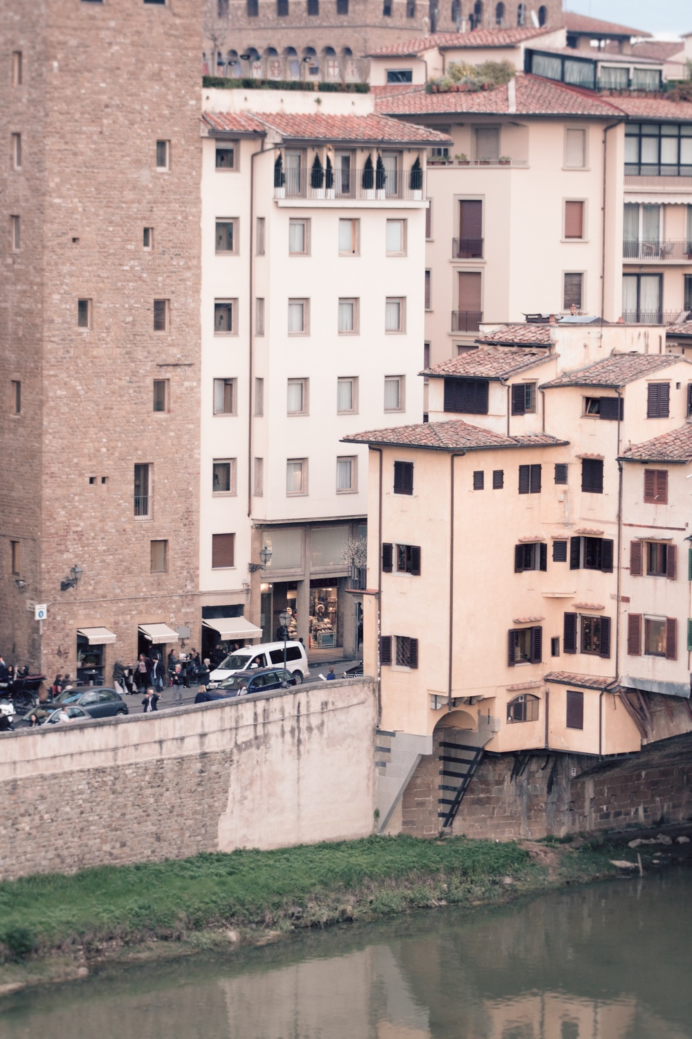 The Continentale is the white building in the middle and the yellow buildings across the street are the windows of the Ponte Vecchio shops