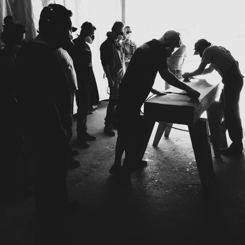 Students of a fabric-forming sink workshop learning how to properly finish a form