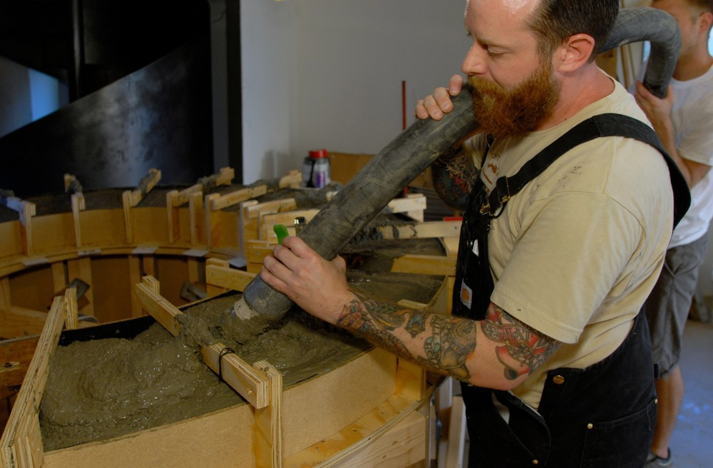 Brandon Gore casting a fabric-formed wall for a restaurant in Phoenix, AZ