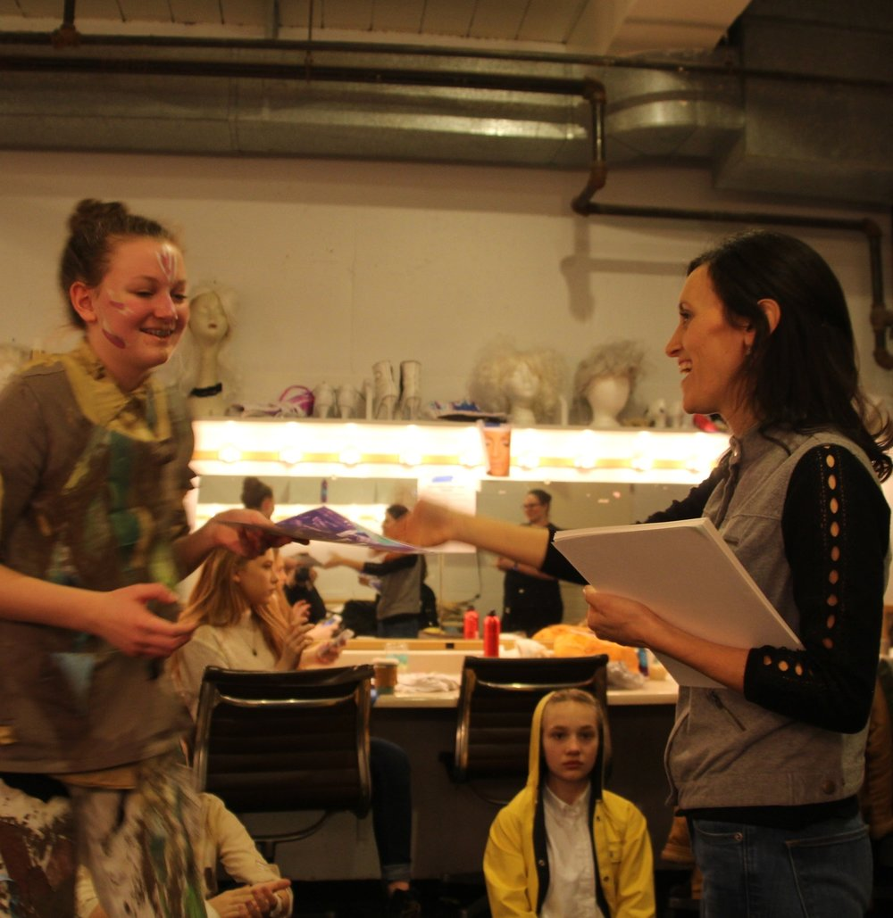 """YAT director Catherine Wade delivers awards (""""Risk Taker Award,"""" """"Becoming the Artwork Award,"""" """"Power in Performance Award,"""" etc.) before the final performance of Unmasked, the Kidz Intensive show at the IMA. January 2017."""