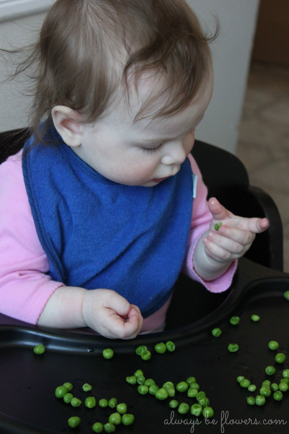 Picking up peas helps develop fine motor skills.