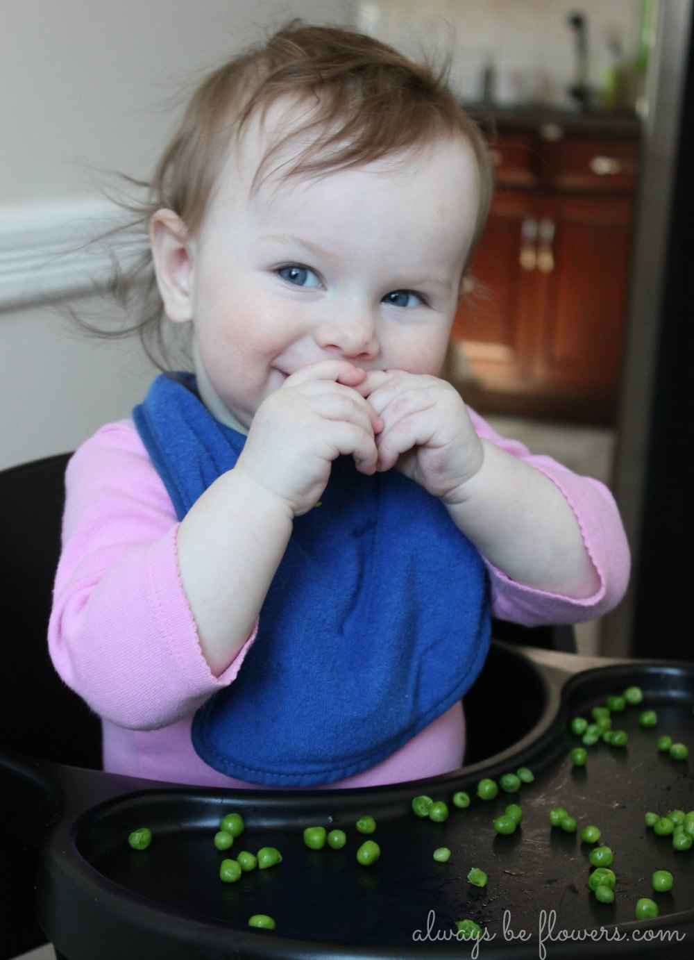 baby-happy-eating-peas.jpg