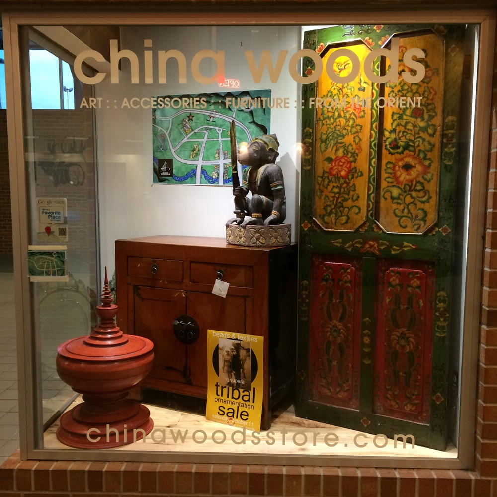 In the display now is temple offering bowl from Burma,  an orange lacquer cabinet from China, a teak Hanuman statue from Burma, and door from China