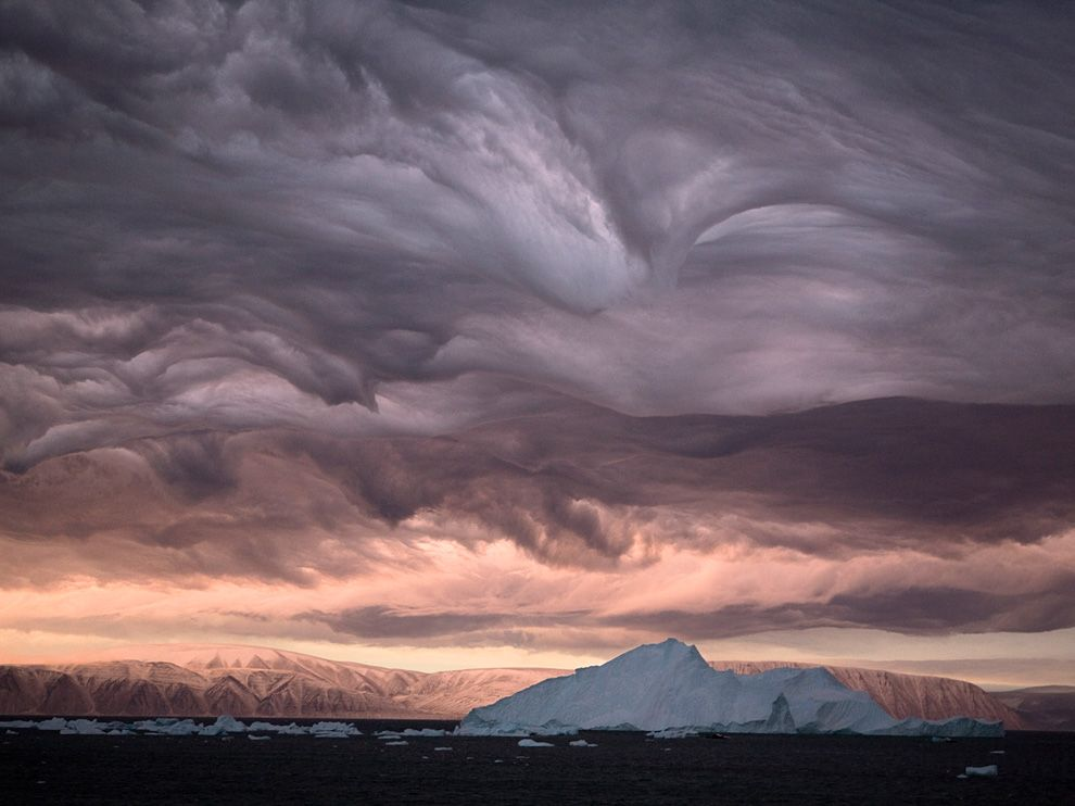 #explorationsundays    As part of #explorationsundays, this week I found a two-fer: an incredible image and a awesome new tumblog for me to follow.  National Geographic Daily  — you now have my attention :)    nationalgeographicdaily :      Stratus Clouds, Greenland  Photo: Bryan and Cherry Alexander     Eight hundred miles south of the North Pole, stalactite-like stratus clouds - churned by 90-mile-an-hour winds - and the light of a bruised dawn paint an apocalyptic portrait over Inglefield Bay.