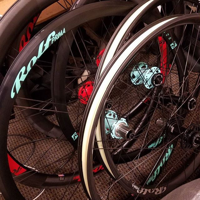 I see custom wheels . Red hubs, mint hubs, oh my. #builtrighthere #madeinusa #handmade #celeste #customwheels #madeforme #newwheelday