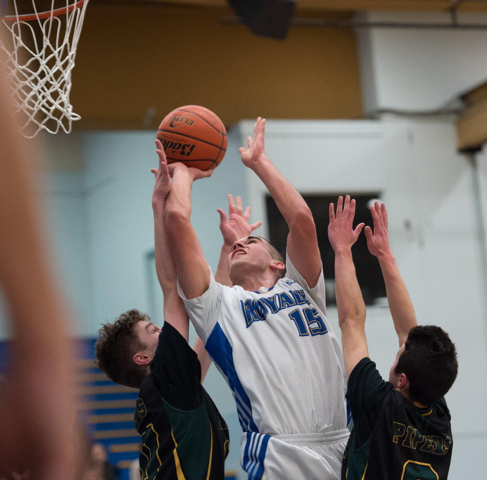 Handsworth's Player of the Game, Ben Grant stretches for 2 of his 21 points as the Handsworth Royals defeated the Argyle Pipers in AAA action at the Howe Sound Championships.
