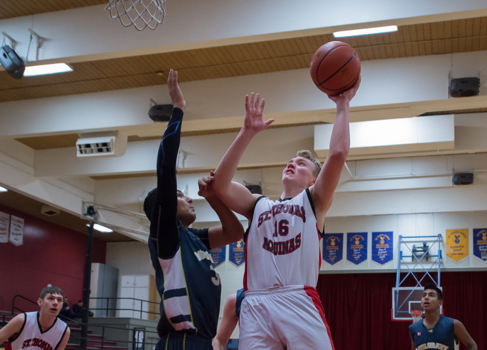 STA's Erik Dahl attacks the hoop early in the first quarter of the STA /Mulgrave game which STA went on to win 95-58. STAwill now face Collingwood in the 2018 AA Howe Sound Championships