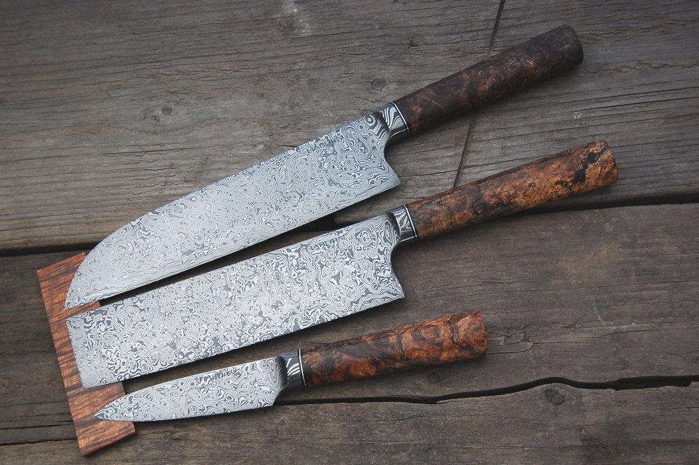 Raindrop Damascus Integrals handle in nickel silver and maple burl.