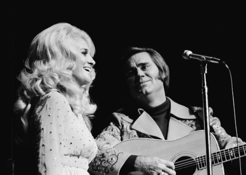 Tammy Wynette and George Jones singing together