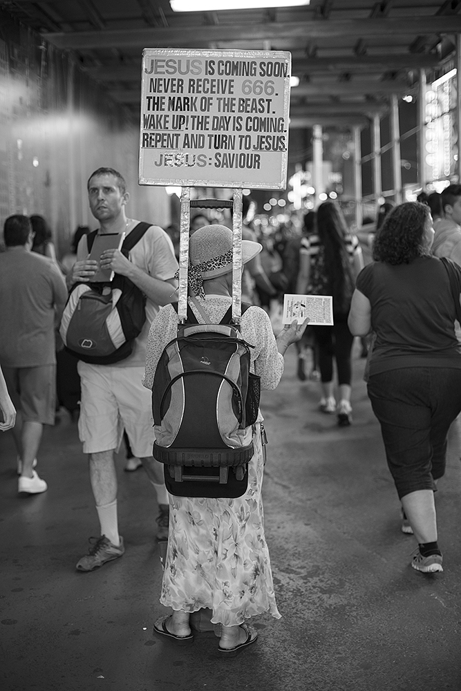 One of the most common of signs is probably the Jesus sign. This woman is a stalwart around Times Square. I really like the way her sign is rigged. It's a little strange to me that she has the '666' matching 'Jesus', both in red lettering.