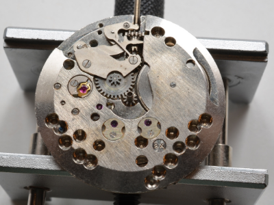 The cap jewels on the bottom of the movement as well as the bottom of the balance shock protection system and the keyless winding system can be seen here.