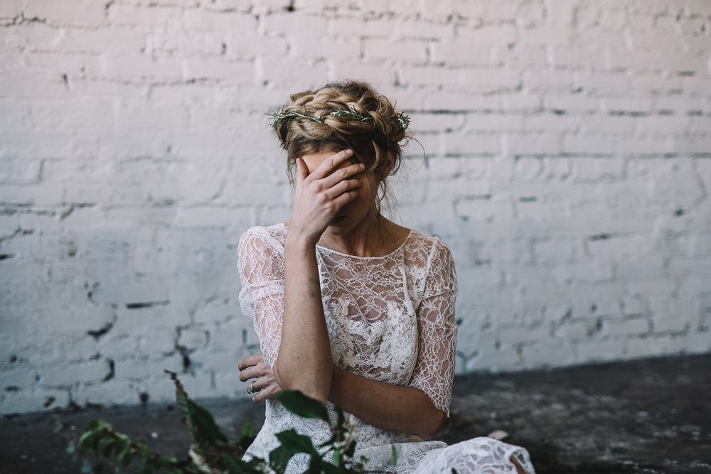 organic and industrial bridal inspiration by Jess Hunter, Seattle warehouse wedding inspiration, warehouse indoor wedding with greenery decor, wild foraged bouquet in Seattle wedding, rosemary floral crown bride style