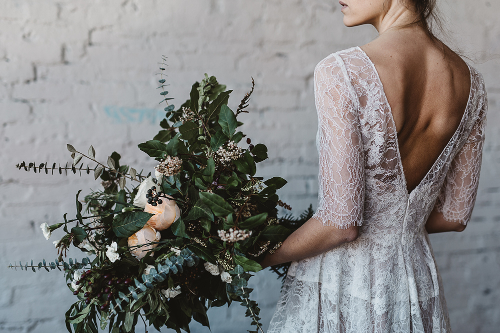 organic and industrial bridal inspiration by Jess Hunter, Seattle warehouse wedding inspiration, warehouse indoor wedding with greenery decor, wild foraged bouquet ina Seattle wedding, rosemary floral crown bridal style, modern industrial wedding, artistic wedding photography
